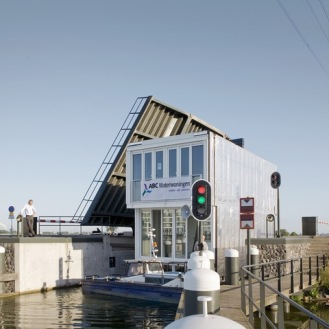 "These floating homes on the Ijsselmeer in The Netherlands are connected by docks but give the perception of a seemingly detached layout of water dwellings. The floating homes are supported by concrete ""tubs"" submerged in the water to a depth of half a story and a lightweight supporting steel construction is built on top. Features such as sunrooms, verandas, floating terraces and awnings can be attached. by Architect MarliesRohmer/Photo Marcel vanderBurg"