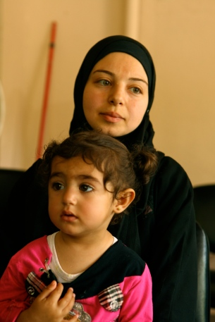 A mother from Aleppo, Syria waits with her daughter at a 24 hour makeshift clinic for refugees in northern Lebanon. There are now nearly half a million Syrian refugees in Lebanon. See my other post with stories from some of the refugees I've met: http://bit.ly/11IMM7S