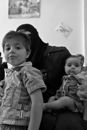 """I don't have any milk to give to my baby and I can't afford to buy any."" -Ranis, 28, with children Bayan and Hamad"