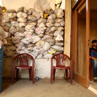 Sandbags enclose a shisha cafe in Bab al-Tabbaneh. by Saskia de Melker